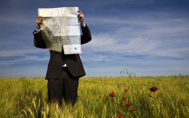 business-man-looking-at-map