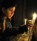child-with-prayer-candles