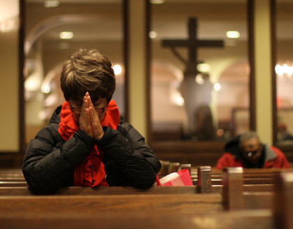 A woman prays on Ash Wednesday at St. Francis of Assisi Church in New York Feb. 13. Ash Wednesday marks the start of the penitential season of Lent, a time of reflection, prayer, fasting and charity before Easter. (CNS photo/Gregory A. Shemitz) (Feb. 13, 2013)